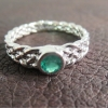 five-strand-knot-ring-with-emerald-14-karat-white-gold