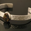 hand-engraved-bangle-bracelt-with-fire-agate-sterling-silver-web